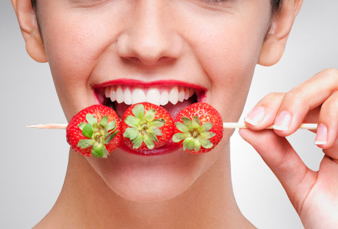 getty_rm_photo_of_woman_eating_strawberries